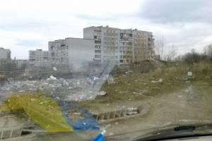 Смітник по вул.Коваліва, 26,26а